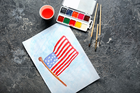 Watercolor painting of American national flag on grey table