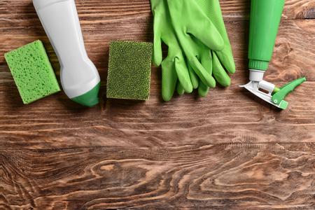 Cleaning supplies on wooden background Reklamní fotografie