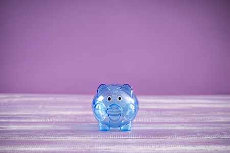 Cute piggy bank on table