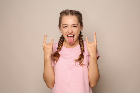 Portrait of funny young woman on light background Stock Photo