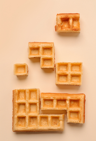 Creative composition with waffles on light background