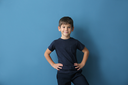 Cute little boy in t-shirt on color background
