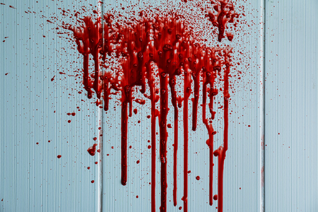 Blood stains on light wall Stock Photo