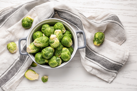 Casserole with fresh brussels sprouts on table, top view