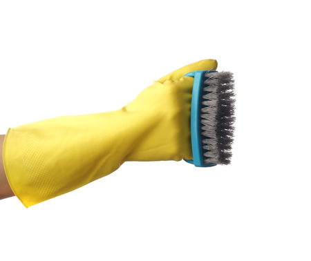 Woman holding brush for cleaning on white background