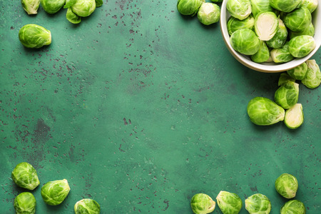 Fresh brussels sprouts on color background with space for text