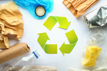 Different garbage with symbol of recycling on white background. Ecology concept Stock Photo