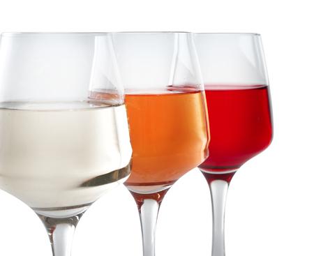 Glasses of tasty wine on white background, closeup