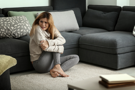 Woman having panic attack at home