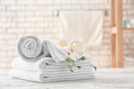 Towels with flowers on light table