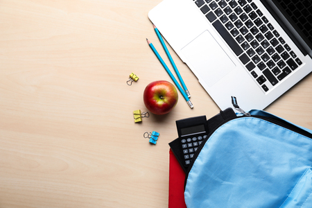 Composition with rucksack and school stationery on light background, top view Stock Photo