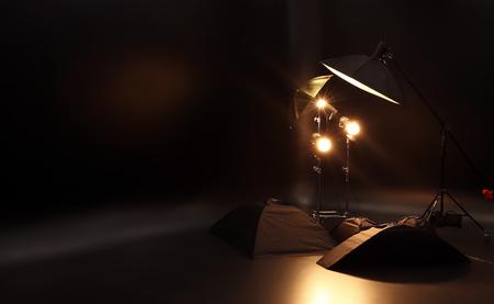 Interior of modern photo studio with professional lighting equipment Foto de archivo