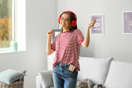 Beautiful woman listening to music at home