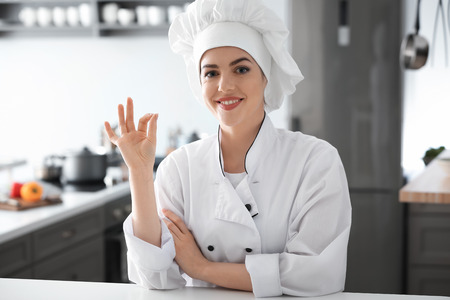 Young female chef in kitchen