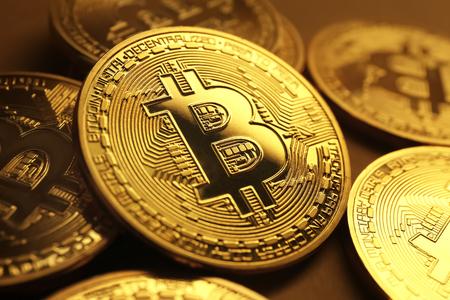 Golden bitcoins on table, closeup