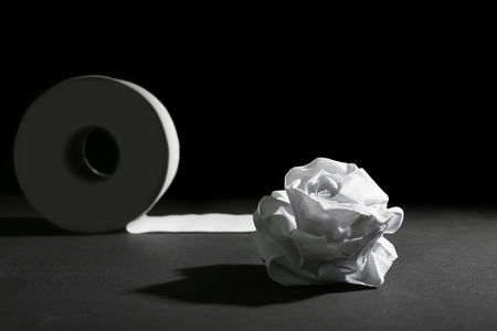Toilet paper on dark background