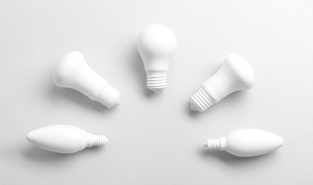Different light bulbs on white background
