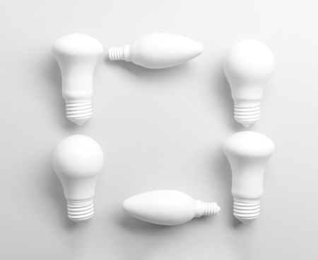 Frame made of light bulbs on white background