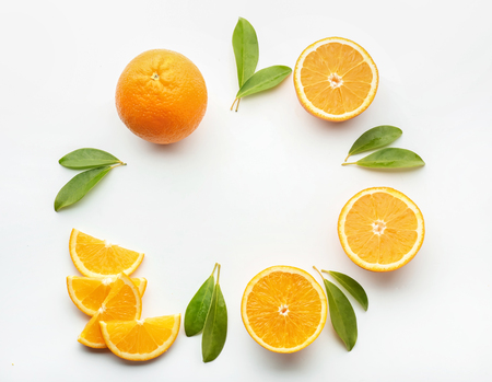 Frame made of tasty ripe oranges on white background