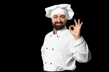 Male chef on dark background