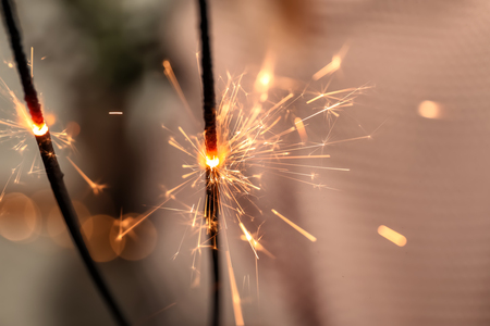 Christmas sparklers on blurred background, closeup 免版税图像