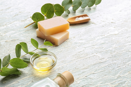 Eucalyptus essential oil and soap on white background