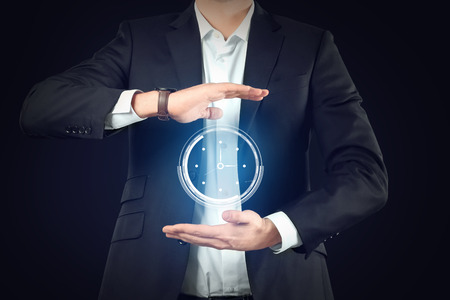 Businessman with virtual clock on dark background. Time management concept