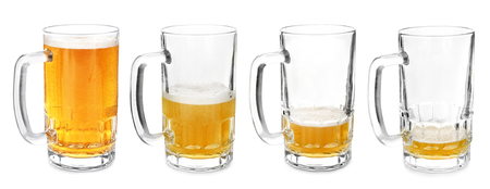 Mugs with different amount of beer on white background Imagens
