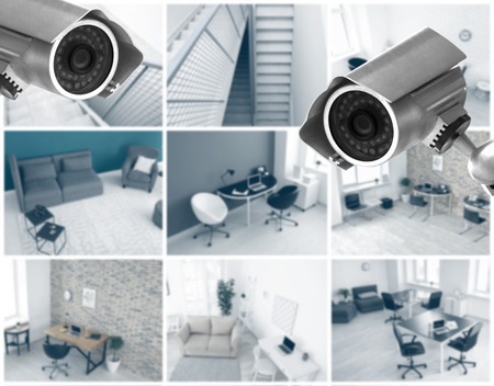 Modern CCTV cameras with blurred view of office locations