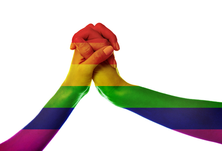 Young women holding hands painted as the rainbow flag on white background. LGBT concept