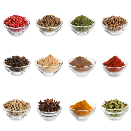 Different spices in bowls on white background