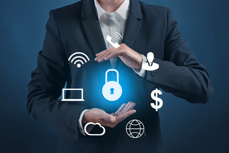 Businesswoman with icons and padlock on dark background. Data security concept