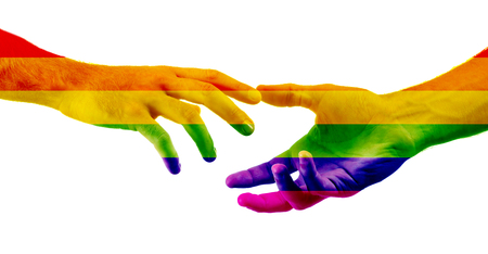 Male hands painted as the rainbow flag reaching out to each other on white background. LGBT concept