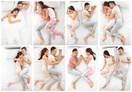 Young couple sleeping in different positions on bed, top view 免版税图像