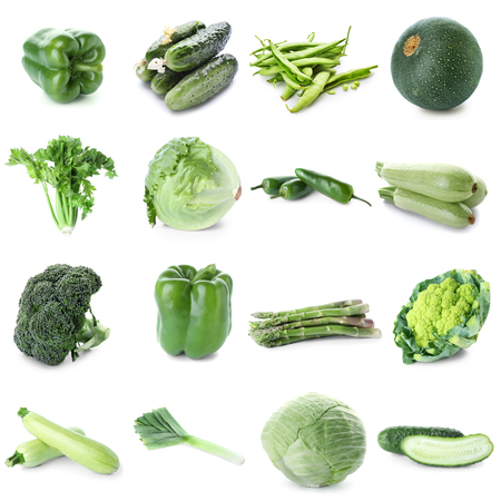 Different fresh green vegetables on white background
