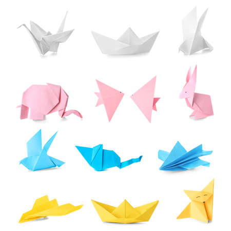 Many origami figures on white background Stock Photo