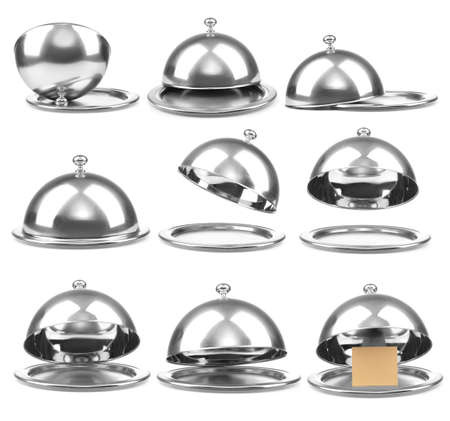 Trays with cloches on white background