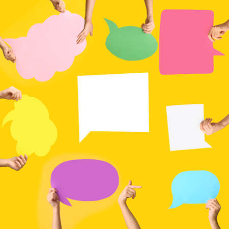 Many female hands with blank speech bubbles on color background