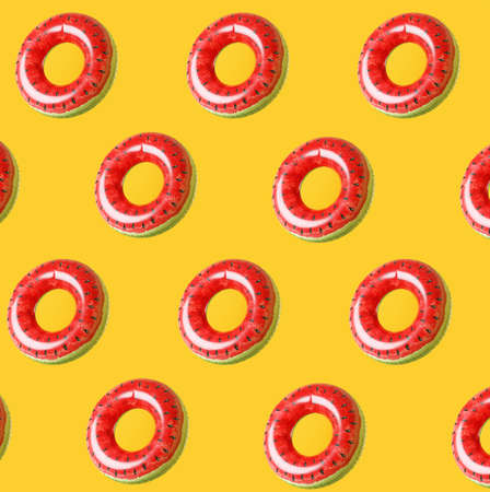 Many inflatable rings on color background
