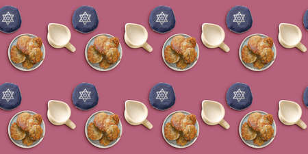 Tasty potato pancakes for Hanukkah and Jewish hats on color background