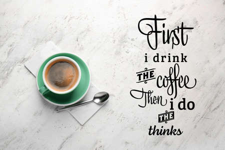 Cup of hot coffee and text JUST I DRINK COFFEE THEN I DO THINKS on light background