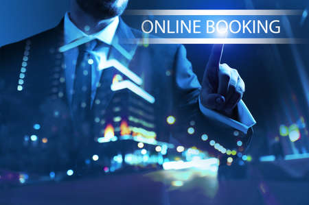 Businessman using virtual screen for online booking at night