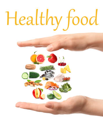 Female hands with different healthy food on white background