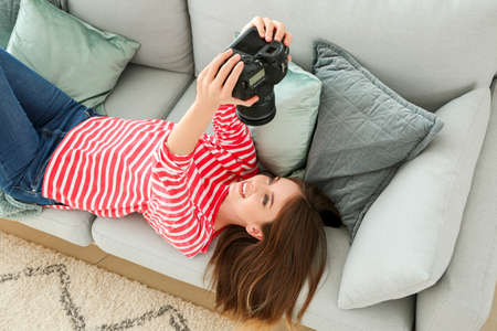 Young female photographer at home
