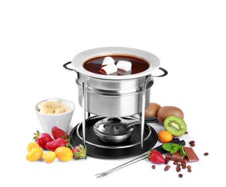 Fondue pot with melted chocolate, fruits and marshmallows on white background