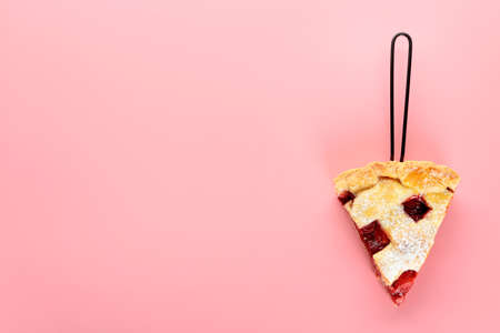 Piece of tasty strawberry pie on color background
