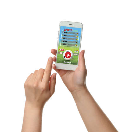 Female hands with open page of online betting site on screen of mobile phone against white background