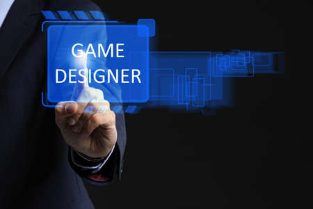 Male video games designer using virtual screen on dark background