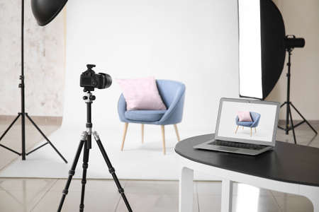 Interior of modern studio during photographing of furniture