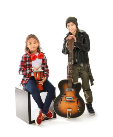 Band of little musicians on white background